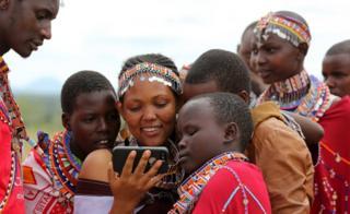 Ethiopian woman looking at phone
