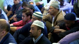 Muslim men worshipping at Friday prayers in Belfast