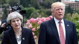 "Britain""s Prime Minister Theresa May, US President Donald Trump and German Chancellor Angela Merkel arrive to watch an Italian flying squadron during the Summit of the Heads of State and of Government of the G7, the group of most industrialized economies, plus the European Union, on May 26, 2017"