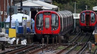 Forensic investigators at Parsons Green tube station