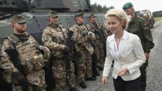 German Defence Minister Ursula von der Leyen chats with soldiers on June 29, 2016