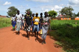 Women walking in Mungula