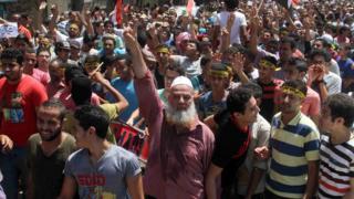 Mısır'daki askeri darbenin birinci yıldönümümde protesto düzenleyen Müslüman Kardeşler destekçileri