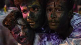 Pakistani Hindu youths celebrate the holi festival in Karachi on March 1, 2018.