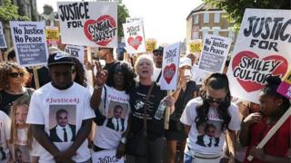Demonstrators walking the route of the original protest five years since the death of Mark Duggan
