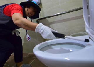 Seoul - checking toilet for hidden camera