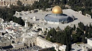 An aerial view shows the Dome of the Rock on the compound known to Muslims as the Noble Sanctuary and to Jews as Temple Mount, and the Western Wall (left) in Jerusalem's Old City October 2006