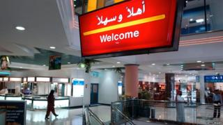 A McDonald's sign reads 'Welcome' in both English and Arabic October 15, 2002 in Dubai, United Arab Emirates