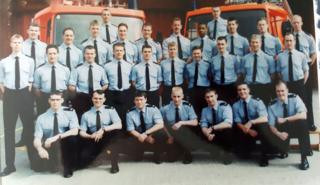 Phil Murphy after completing 12 weeks basic fire-fighter training 20 years ago, second from the left, front row.