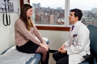Dr Joel Salinas talks to a patient