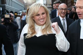 Rebel Wilson celebrates as she leaves court in Melbourne, Australia.