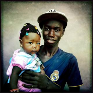 Man holding his baby daughter
