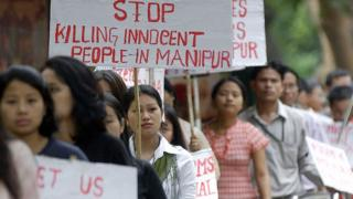 Indian students from the country's northeastern state of Manipur take part in a rally in Bangalore, 13 August 2004, to protest against the alleged killing in military custody of a 30-year-old woman