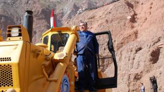 Tajik President Emomali Rahmon posed on a bulldozer he operated himself