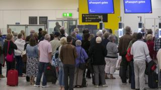 People queuing at Gatwick