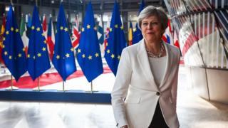 Theresa May arriving at EU Summit