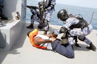 Members of the Ivory Coast Navy take part in a multinational naval exercise off the coast of Abidjan, Ivory Coast, March 27,