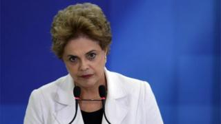 Brazil's President Dilma Rousseff pauses as she addresses teachers and students during a ceremony at Planalto presidential palace in Brasilia, Brazil, Tuesday, April 12, 2016.