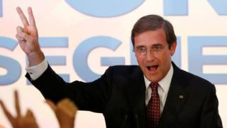 Portugal's Prime Minister Pedro Passos Coelho (left) celebrating after results become clear
