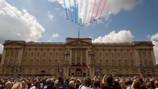 The Red Arrows display team fly over Buckingham Palace following the Queen's Birthday Parade