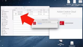 A Mac desktop with Creative Cloud being installed
