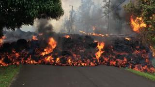 Lava covers a tarmac road