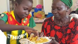 Nyardhan Girmal and her child Jany