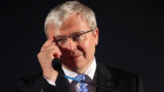 In this 2013 file photo, former Australian Prime Minister Kevin Rudd adjusts his glasses during a speech at a pre-election rally in Mt. Druitt, Australia.