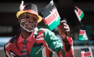 "People wave Kenyan flags during the Independence Day ceremony, called Jamhuri Day (""Republic"" in Swahili) at Kasarani stadium in Nairobi, Kenya, on December 12, 2017."