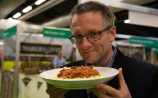 Michael Mosley with a plate of his reheated curry