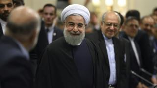 Iranian President Hassan Rouhani attends a meeting with French ministers and representatives of the Movement of the Enterprises of France (MEDEF) in Paris on 27 January 2016