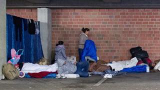 Migrants sleeping rough in a garage in Hamburg, 30 Sep 15