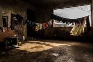 Washing hangs in one of the corridors of the occupied IBGE building. 'Favela' Mangueira community, Rio de Janeiro, Brazil.