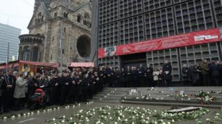 Mourners attend the inauguration of a memorial to victims at the site of the 2016 Christmas market terror attack at Breitscheidplatz