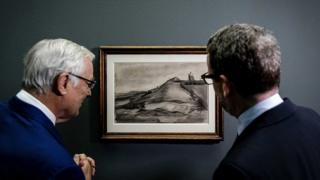 Two men looking at recently discovered Van Gogh sketch