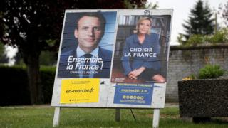 Posters of the two candidates seen in Sorrus, northern France