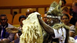 A praise singer in traditional dress chants praise from the public gallery in parliament in Cape Town, South Africa - Wednesday 22 February 2017