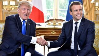 US President Donald Trump (left) shakes hands with French President Emmanuel Macron during their meeting at the Elysee Palace in Paris, France, 13 July 2017