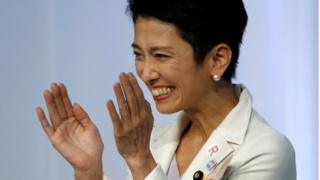 Japan's main opposition Democratic Party's new leader Renho (L) smiles after she was elected as the party leader at the party plenary meeting in Tokyo, Japan September 15, 2016.