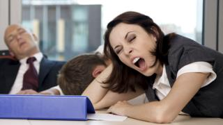 People yawning and asleep in the office