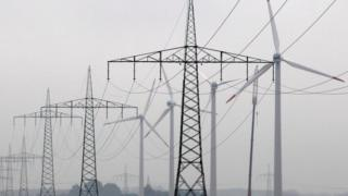 Electricity pylons and wind turbines (Image: Reuters)