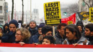 "Protesters carry posters reading ""don't let Nazis govern"" in Vienna, Austria, 13 January 2018."
