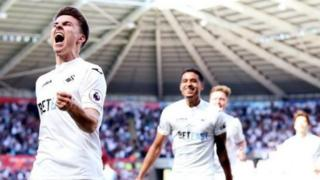 Tom Carroll celebrates goal