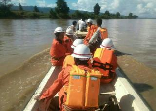 In this handout photograph released by the Myanmar Fire Services Department on October 17, 2016, government rescue personnel from the Myanmar Fire Services Department take part in a search operation on the Chindwin River after a ferry capsized near Monywa city in Sagaing region
