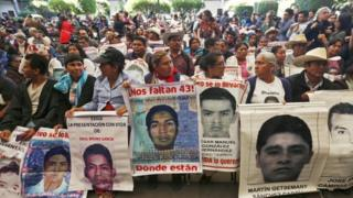 Relatives of the 43 missing students attend the delivery of the panel's final report in Mexico City