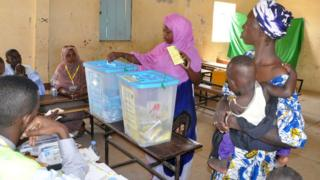 A woman casts her vote in country's constitutional referendum on 5 August at the polling station in Nouakchott