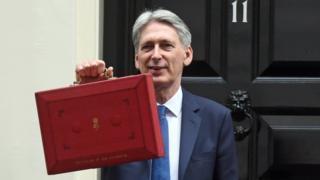 Philip Hammond carrying the budget box