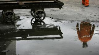 Reflection of a miner