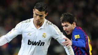 Cristiano Ronaldo y Lionel Messi en juego