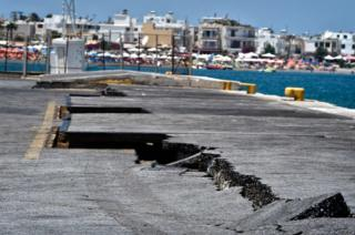 Cracks are seen at the main port on the island of Kos on 21 July 2017, following a 6.7 magnitude earthquake which struck the region.